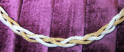 Gold and silver herringbone plait