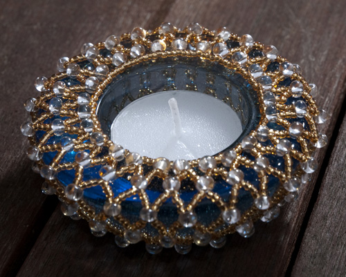 Image of a beaded tea light holder