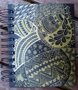 Gold pen on the notebook cover
