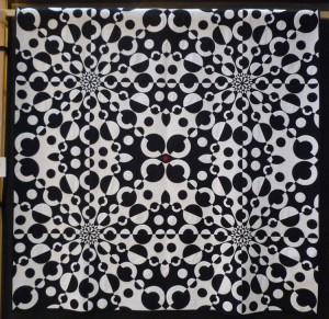 A picture of the quilt titled 'Punto Óptico'